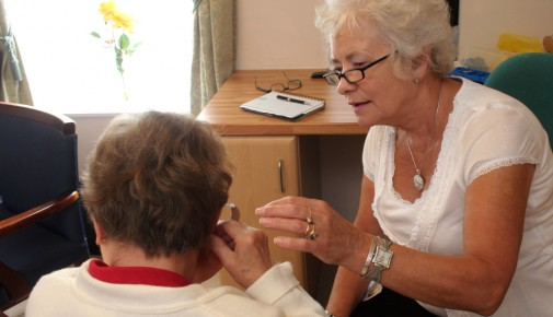 Practical support and advice being provided to a hearing aid user at one of our drop-in clinics